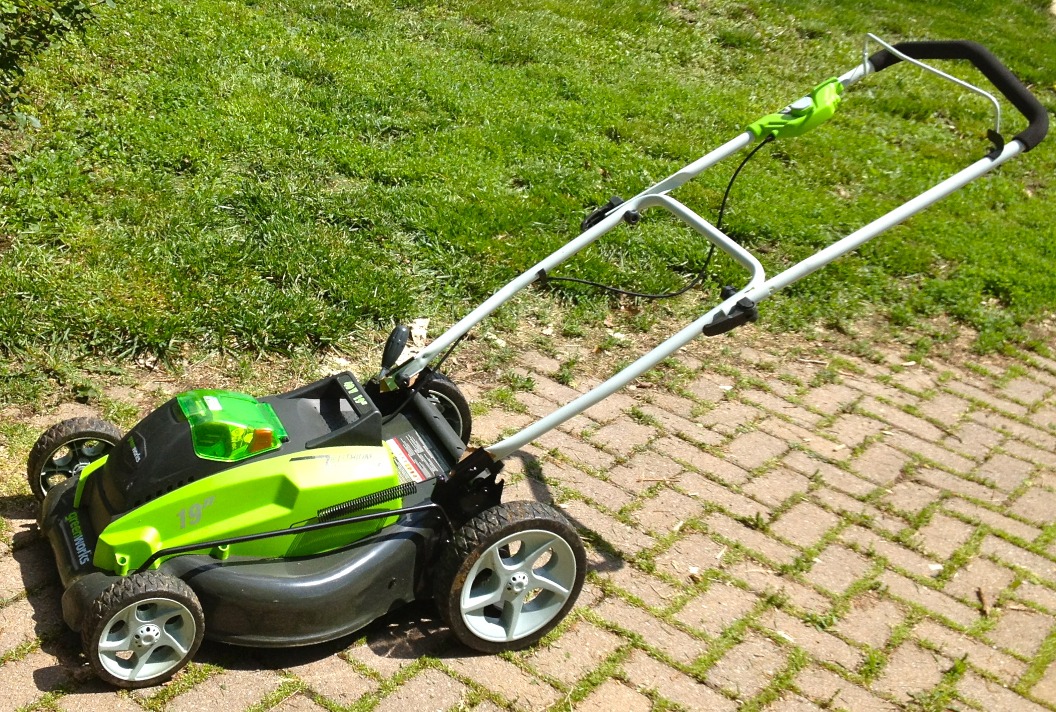 My Big Bright Green Battery Powered Lawn Mowing Machine